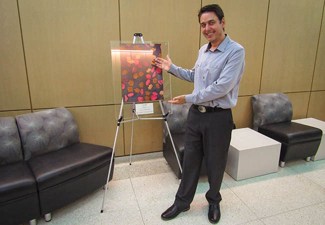 Dr. Bleher poses with his submission,