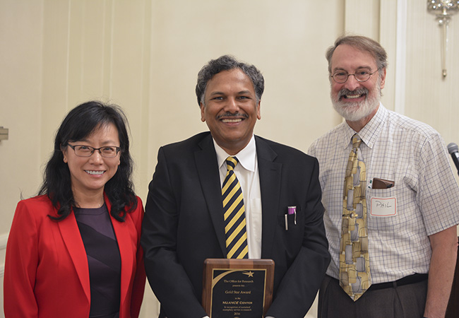 Vinayak Dravid accepts NUANCE's Gold Star Awar from Jian Cao and Phil Hockberger, Office for Research