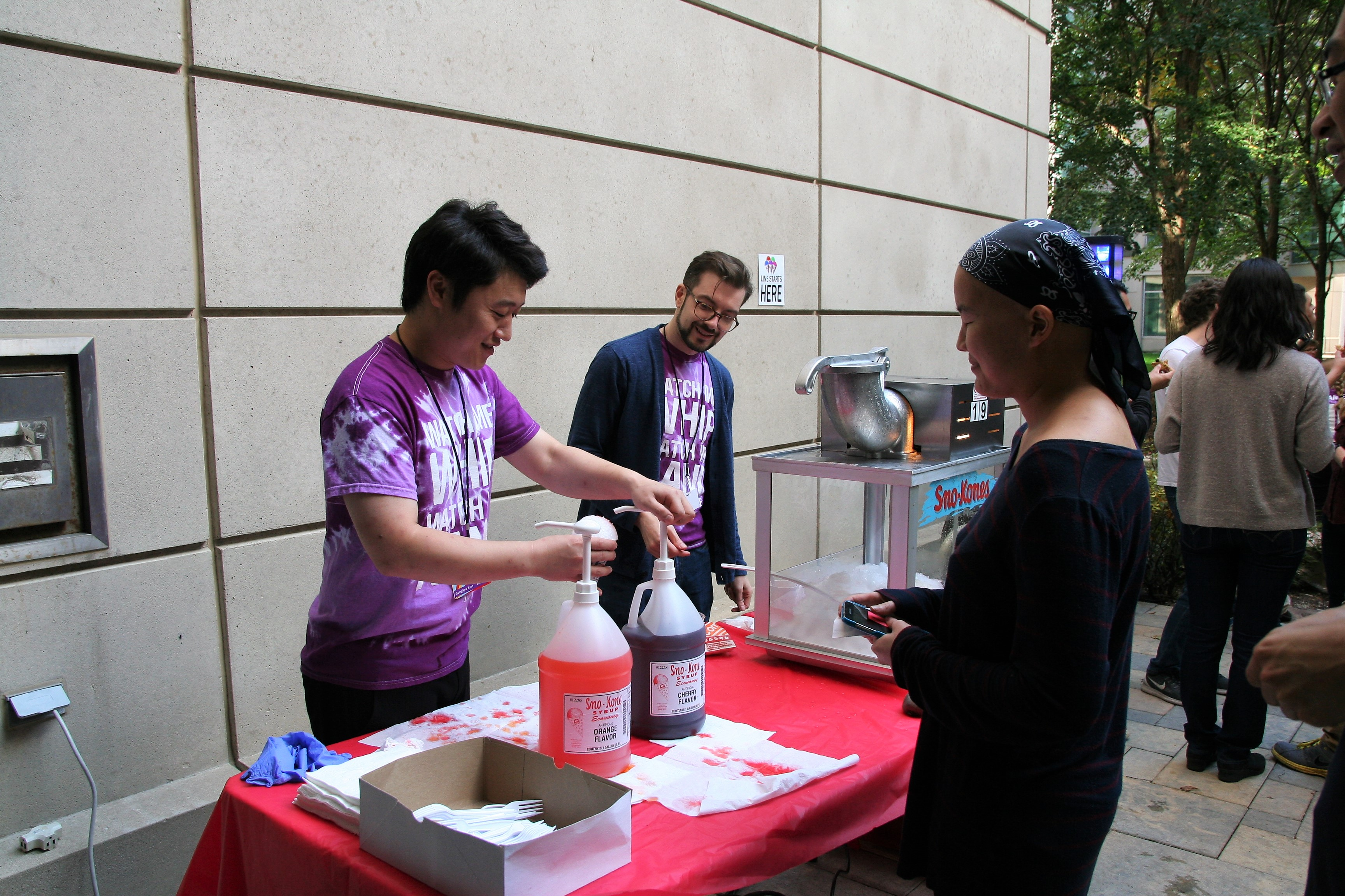 Dr. Sungkyu Kim and Eric Roth make sno cones.